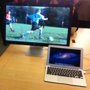 Photo of a 27 inch external screen being used by a mid-2011 MacBook Air i5 11 inch model