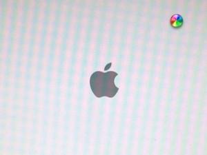 Screenshot of hung OS X Mavericks upgrade hung with a spinning beachball